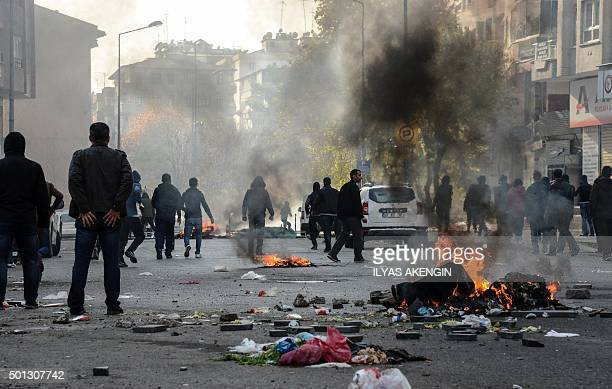Kurds clash with the Turkish police as they protest against the recent curfews imposed on Kurdish towns on December 14 in downtown Diyarbakir The...