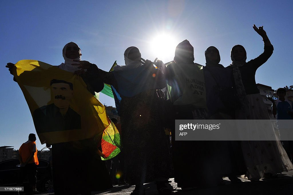 Kurds dance with a picture of PKK (Kurdistan Workers Party) jailed leader Abdullah Ocalan during a protest on June 30, 2013, in Diyarbakir. Turkish security forces killed one person and wounded seven on June 28 when they fired on a group of people protesting against the construction of a new gendarmerie outpost in the Kurdish-dominated southeastern Turkey, security sources said.