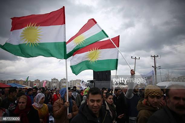 Kurds from Turkey and Syria hold up Kurdistan flags as they celebrate Kurdish New Year on March 21 2015 in Diyarbakir Turkey Diyarbakir has one of...