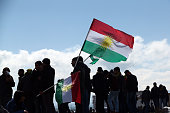Kurds from Turkey and Syria hold up Kurdistan flags as they celebrate Kurdish New Year on March 21 2015 in Diyarbakir Turkey Diyarbakir has one of...