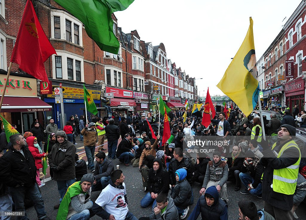 Kurds living in the UK rally in north London on January 13, 2013 to demand justice for three top Kurdish activists from a separatist group who were killed earlier this week in France. The three activists -- Sakine Cansiz, Fidan Dogan and Leyla Soylemez -- were found dead on January 10 at the Kurdistan Information Centre in the grimy 10th district of Paris, after last being seen alive at the centre at midday on January 9. AFP PHOTO / CARL COURT