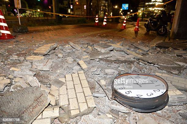 Kure Japan Fragments of a wall and other objects lie scattered on a sidewalk in Kure Hiroshima Prefecture after an earthquake with a preliminary...