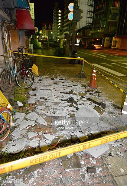 Kure Japan Fragments of a wall lie scattered on a sidewalk in Kure Hiroshima Prefecture after an earthquake with a preliminary magnitude of 62 struck...