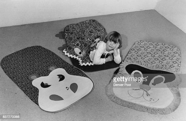 Kurlups by Mary Middleton of Mary's Thing's Castle Rock are whimsical sleeping bags in bright calice prints with hippo crocodile lion faces and cozy...