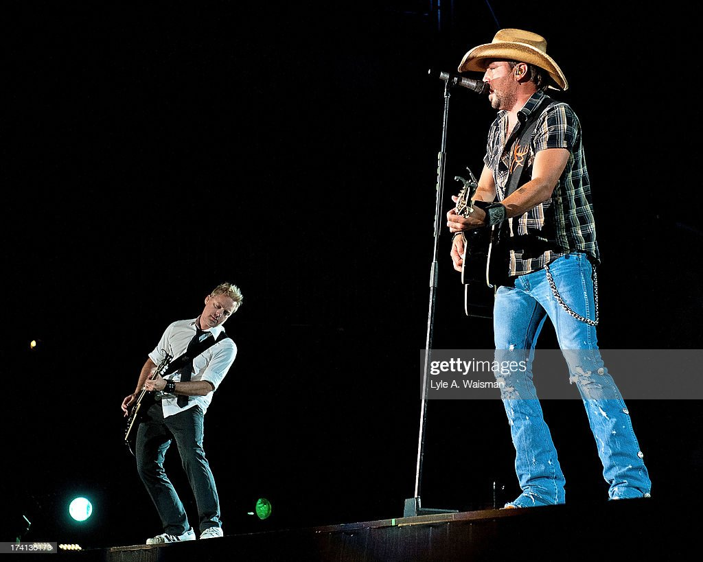 Kurt Allison and <a gi-track='captionPersonalityLinkClicked' href=/galleries/search?phrase=Jason+Aldean&family=editorial&specificpeople=619221 ng-click='$event.stopPropagation()'>Jason Aldean</a> perform during the Night Train Tour 2013 at Wrigley Field on July 20, 2013 in Chicago.