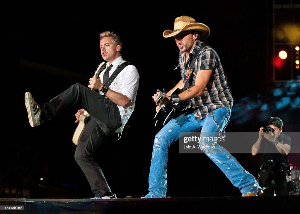 Kurt Allison and <a gi-track='captionPersonalityLinkClicked' href=/galleries/search?phrase=Jason+Aldean&family=editorial&specificpeople=619221 ng-click='$event.stopPropagation()'>Jason Aldean</a> (R) perform during the Night Train Tour 2013 at Wrigley Field on July 20, 2013 in Chicago.