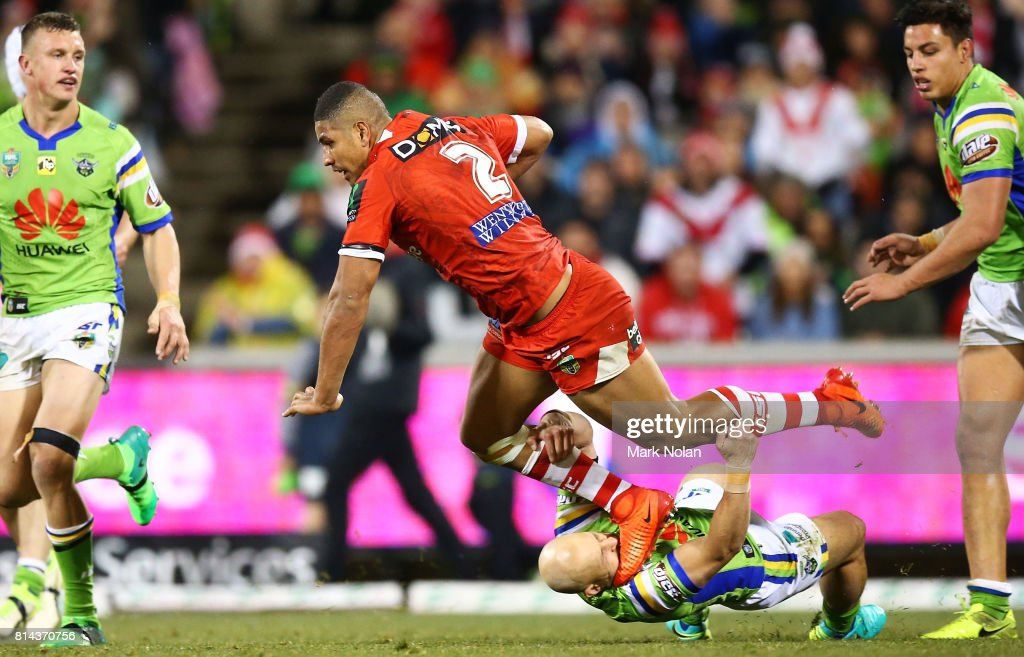 Kurt Baptiste of the Raiders tackles Nene MacDonald of the Dragons during the round 19 NRL match between the Canberra Raiders and the St George Illawarra Dragons at GIO Stadium on July 14, 2017 in Canberra, Australia.