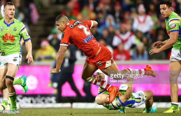 Kurt Baptiste of the Raiders tackles Nene MacDonald of the Dragons during the round 19 NRL match between the Canberra Raiders and the St George...