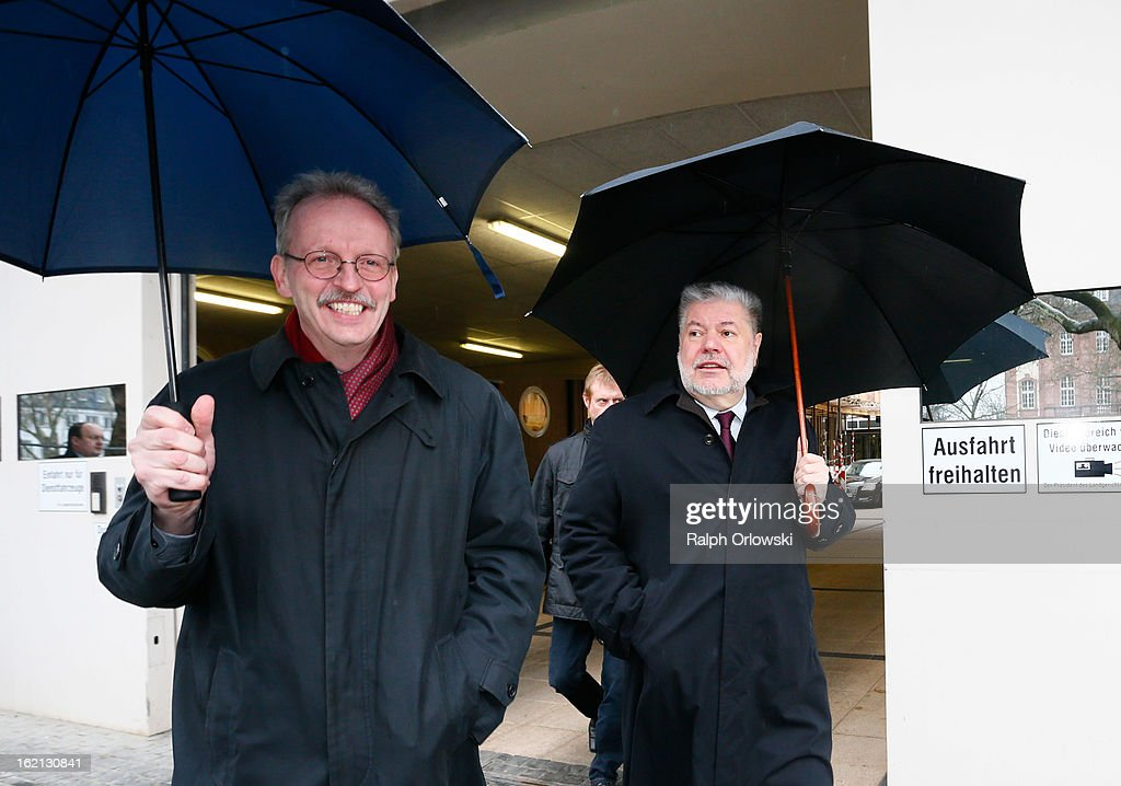 <a gi-track='captionPersonalityLinkClicked' href=/galleries/search?phrase=Kurt+Beck&family=editorial&specificpeople=537056 ng-click='$event.stopPropagation()'>Kurt Beck</a> (R), former Governor of Rhineland-Palatinate, and Martin Stadelmaier, former head of the office of the Governor, depart the courthouse under umbrellas during the Nuerburgring court trial on February 19, 2013 in Koblenz, Germany. Ingo Deubel, who is a former Rhineland-Palatinate finance minister, and five others are accused of breach of trust and other charges in their involvement with investments in the failed Nuerburgring speedway and public park project. The project, which received EUR 500 million in public funding, was supposed to drive job growth in the region but instead went bankrupt.