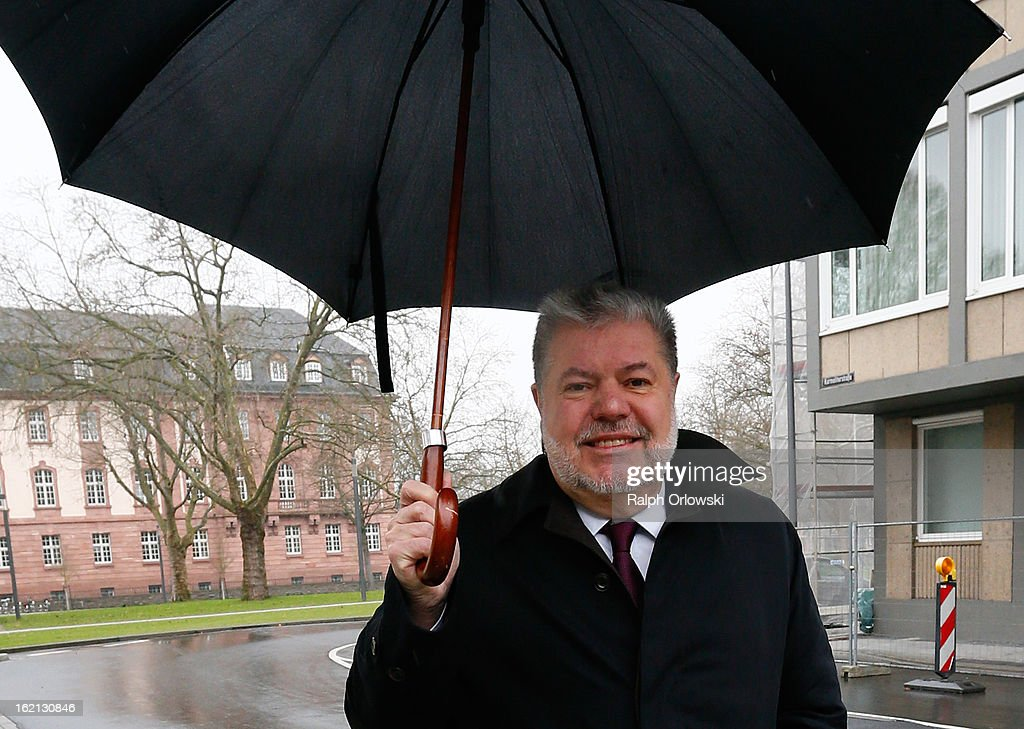 <a gi-track='captionPersonalityLinkClicked' href=/galleries/search?phrase=Kurt+Beck&family=editorial&specificpeople=537056 ng-click='$event.stopPropagation()'>Kurt Beck</a>, former Governor of Rhineland-Palatinate, departs the courthouse under an umbrella during the Nuerburgring court trial on February 19, 2013 in Koblenz, Germany. Ingo Deubel, who is a former Rhineland-Palatinate finance minister, and five others are accused of breach of trust and other charges in their involvement with investments in the failed Nuerburgring speedway and public park project. The project, which received EUR 500 million in public funding, was supposed to drive job growth in the region but instead went bankrupt.
