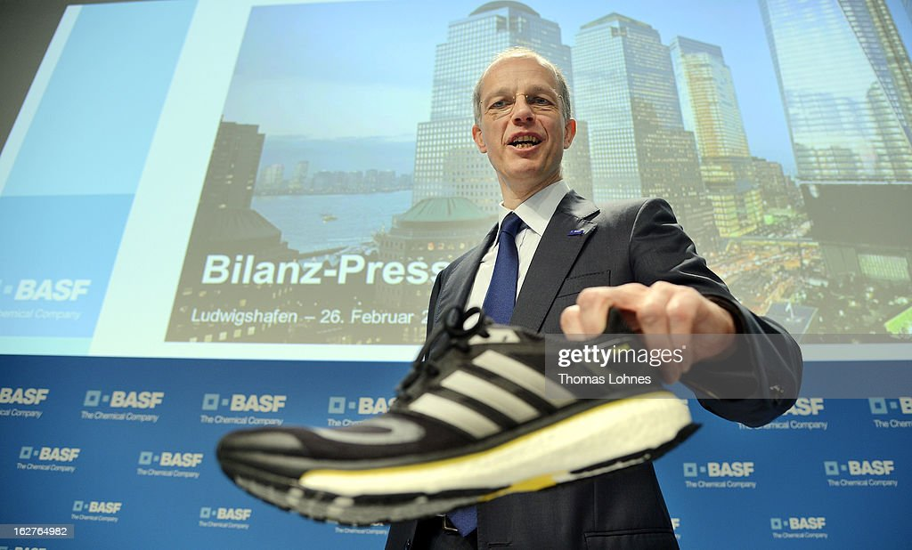 Kurt Bock, Chairman of the Board of Executive Directors at BASF SE, pauses with a brand new addidas running shoe with newly designed Basf technology in the sole, after the company's earnings news conference on February 26, 2013 in Ludwigshafen, Germany. BASF SE, the world's largest chemical company, has projected increased sales this year.