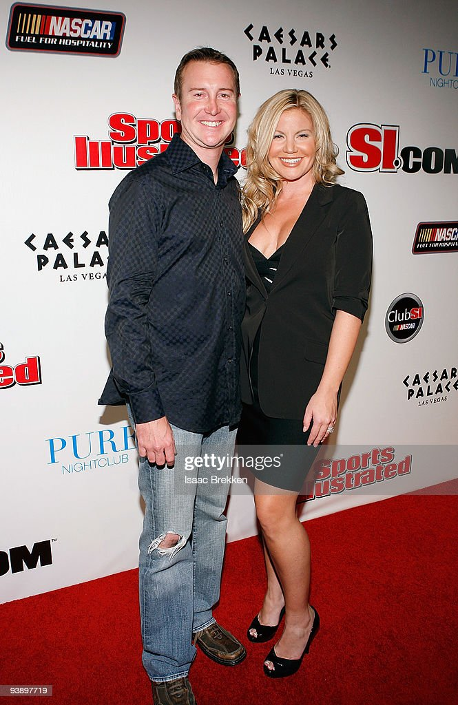 Kurt Busch (L) and wife Eva arrive at Sports Illustrated's Club SI NASCAR at PURE Nightclub at Caesars Palace on December 3, 2009 in Las Vegas, Nevada.