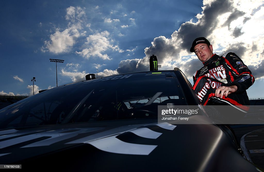 <a gi-track='captionPersonalityLinkClicked' href=/galleries/search?phrase=Kurt+Busch&family=editorial&specificpeople=201728 ng-click='$event.stopPropagation()'>Kurt Busch</a>, driver of the #78 Furniture Row / Beautyrest Chevrolet, climbs from his car after qualifying for the NASCAR Sprint Cup Series Federated Auto Parts 400 at Richmond International Raceway on September 6, 2013 in Richmond, Virginia.