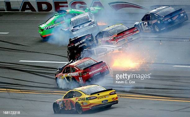 Kurt Busch driver of the Furniture Row / Beautyrest Chevrolet flips and falls on top of Ryan Newman driver of the Haas Automation Chevrolet following...