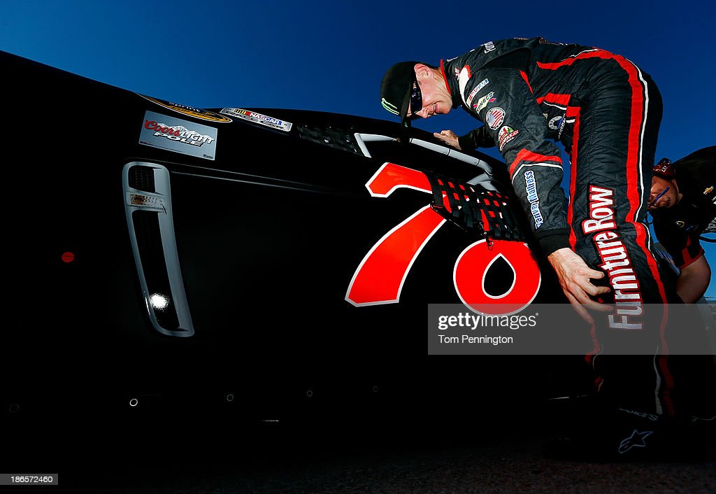 Kurt Busch, driver of the #78 Furniture Row / Denver Mattress Chevrolet, stands on the grid during qualifying for the NASCAR Sprint Cup Series AAA Texas 500 at Texas Motor Speedway on November 1, 2013 in Fort Worth, Texas.