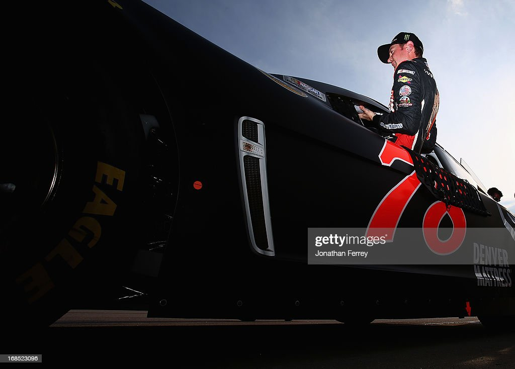 Kurt Busch, driver of the #78 Furniture Row Racing / Serta Chevrolet, climbs out of his car during qualifying for the NASCAR Sprint Cup Series Bojangles' Southern 500 at Darlington Raceway on May 10, 2013 in Darlington, South Carolina.