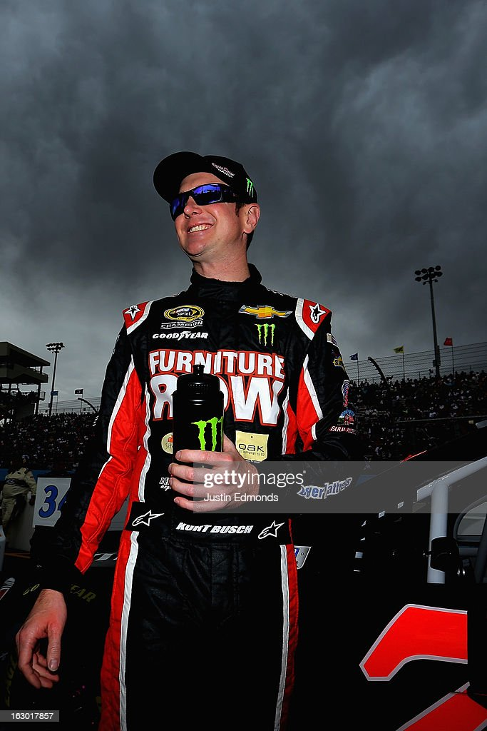Kurt Busch, driver of the #78 Furniture Row/Beautyrest Chevrolet, smiles on pit road before the NASCAR Sprint Cup Series Subway Fresh Fit 500 at Phoenix International Raceway on March 3, 2013 in Avondale, Arizona.
