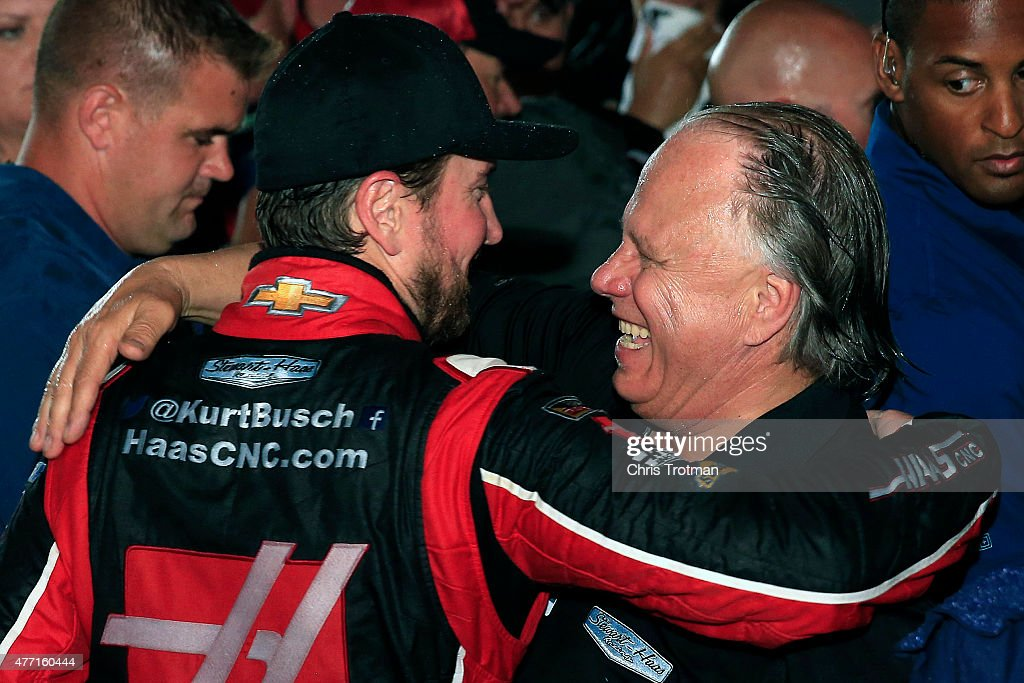 Kurt Busch driver of the Haas Automation Chevrolet and Gene Haas coowner of Stewart Haas Racing celebrate in an alternate Victory Lane after winning...