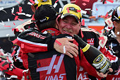 Kurt Busch driver of the Haas Automation Chevrolet and his crew chief Tony Gibson celebrate in Victory Lane after winning the NASCAR Sprint Cup...