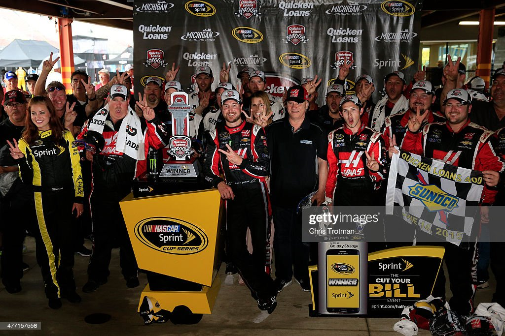 Kurt Busch driver of the Haas Automation Chevrolet and his team pose in an alternate Victory Lane after winning the NASCAR Sprint Cup Series Quicken...
