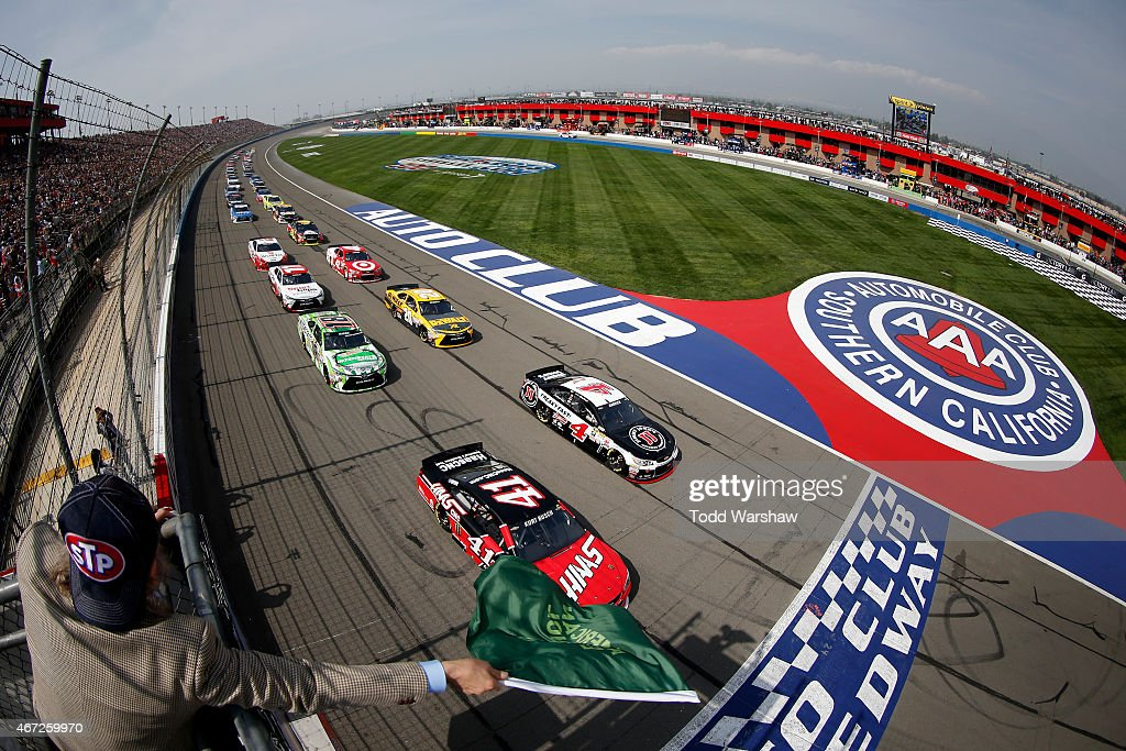 Kurt Busch driver of the Haas Automation Chevrolet and Kevin Harvick driver of the Jimmy John's/Budweiser Chevrolet take the green flag to start the...