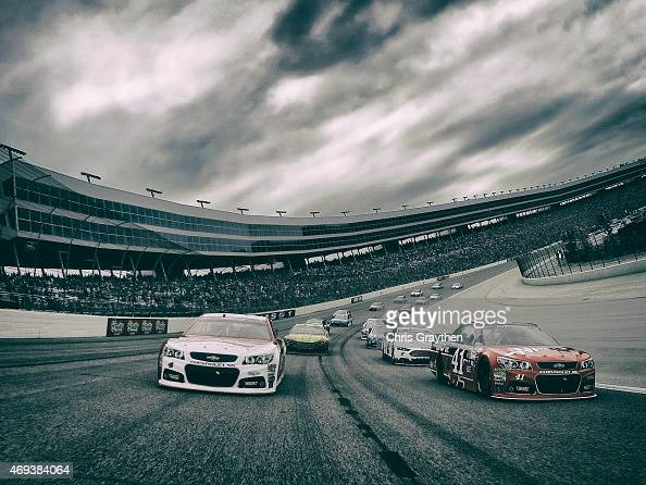 Kurt Busch driver of the Haas Automation Chevrolet and Kevin Harvick driver of the Budweiser/Jimmy John's Chevrolet pace the field behind the pacecar...