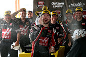 Kurt Busch driver of the Haas Automation Chevrolet celebrates in an alternate victory lane after winning the NASCAR Sprint Cup Series Quicken Loans...