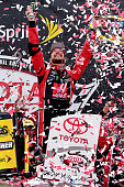 Kurt Busch driver of the Haas Automation Chevrolet celebrates in Victory Lane after winning the NASCAR Sprint Cup Series Toyota Owners 400 at...