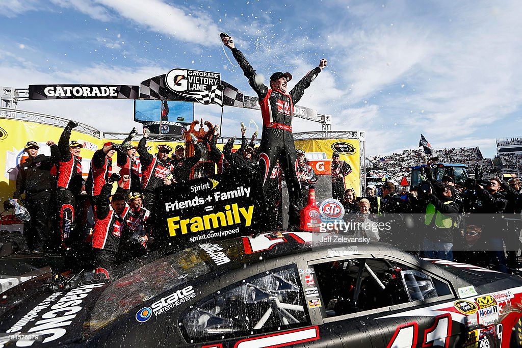 Kurt Busch driver of the Haas Automation Chevrolet celebrates in Victory Lane after winning the NASCAR Sprint Cup Series STP 500 at Martinsville...