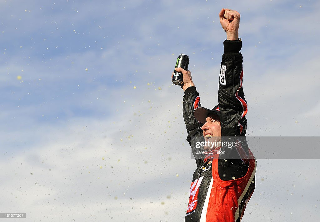 <a gi-track='captionPersonalityLinkClicked' href=/galleries/search?phrase=Kurt+Busch&family=editorial&specificpeople=201728 ng-click='$event.stopPropagation()'>Kurt Busch</a>, driver of the #41 Haas Automation Chevrolet, celebrates in Victory Lane after winning the NASCAR Sprint Cup Series STP 500 at Martinsville Speedway on March 30, 2014 in Martinsville, Virginia.