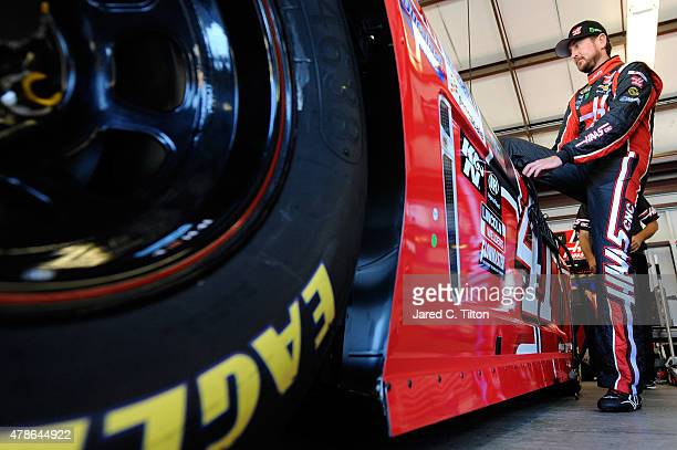 Kurt Busch driver of the Haas Automation Chevrolet climbs into his car during practice for the NASCAR Sprint Cup Series Toyota/Save Mart 350 at...