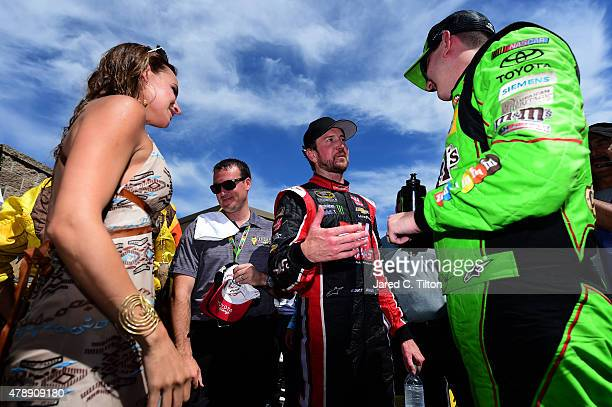 Kurt Busch driver of the Haas Automation Chevrolet congratulates Kyle Busch driver of the MM's Crispy Toyota after winning the NASCAR Sprint Cup...