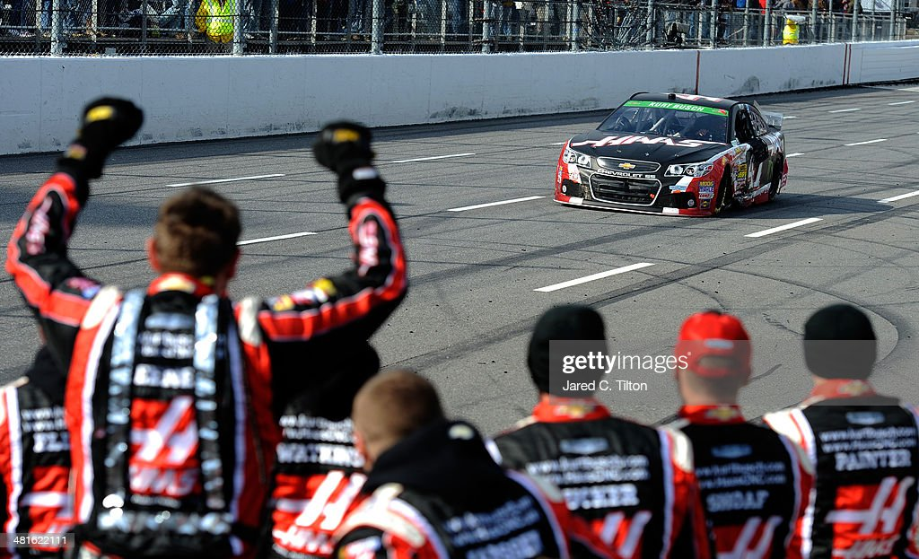 Kurt Busch driver of the Haas Automation Chevrolet is cheered by his crew after winning the NASCAR Sprint Cup Series STP 500 at Martinsville Speedway...
