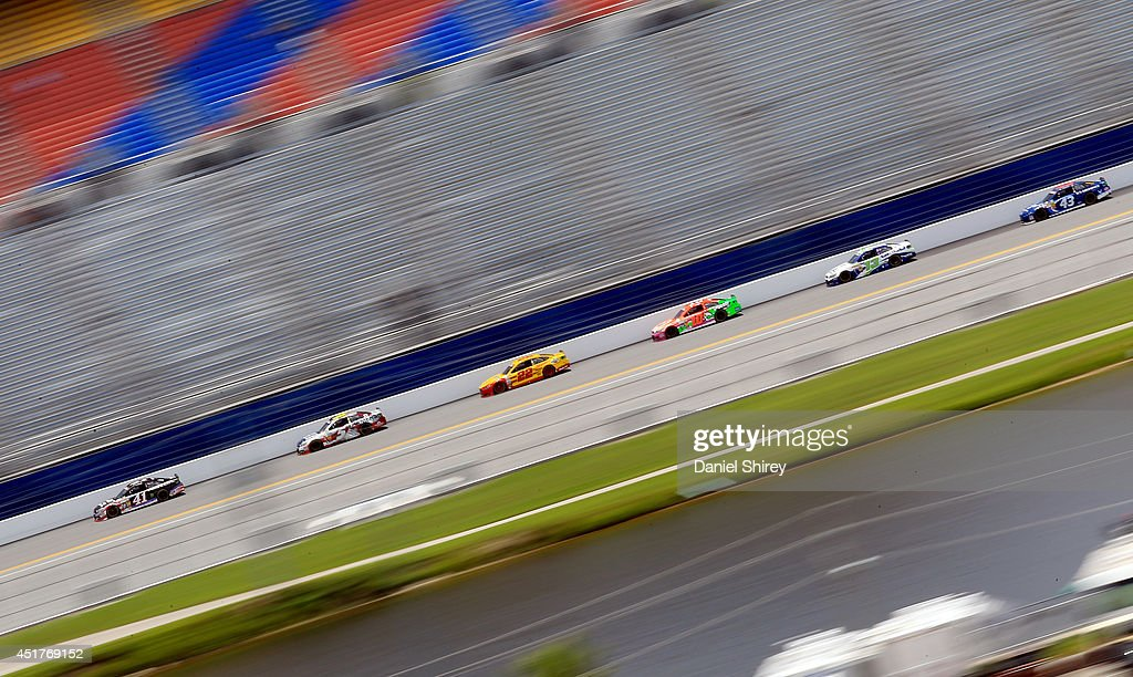 Kurt Busch, driver of the #41 Haas Automation Chevrolet, leads a pack of cars during the NASCAR Sprint Cup Series Coke Zero 400 at Daytona International Speedway on July 6, 2014 in Daytona Beach, Florida.