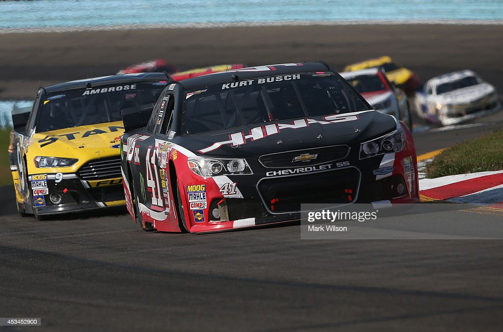 Kurt Busch, driver of the #41 Haas Automation Chevrolet, leads a pack of cars during the NASCAR Sprint Cup Series Cheez-It 355 at Watkins Glen International on August 10, 2014 in Watkins Glen, New York.