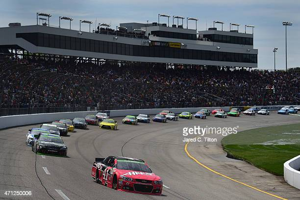 Kurt Busch driver of the Haas Automation Chevrolet leads a pack of cars during the NASCAR Sprint Cup Series Toyota Owners 400 at Richmond...