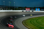 Kurt Busch driver of the Haas Automation Chevrolet leads a pack of cars during the NASCAR Sprint Cup Series Quicken Loans 400 at Michigan...