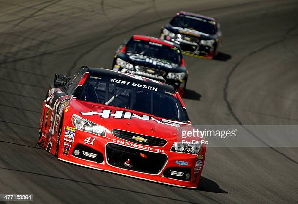 Kurt Busch driver of the Haas Automation Chevrolet leads Kasey Kahne driver of the Great Clips Chevrolet and Dale Earnhardt Jr driver of the AMP...
