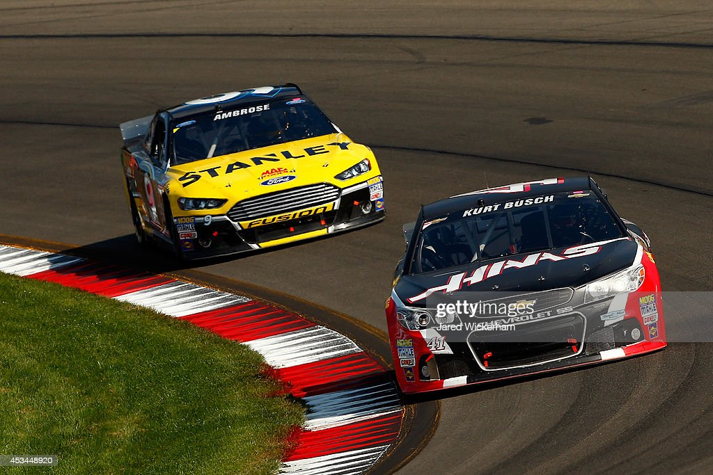 Kurt Busch, driver of the #41 Haas Automation Chevrolet, leads Marcos Ambrose, driver of the #9 Stanley Ford, during the NASCAR Sprint Cup Series Cheez-It 355 at Watkins Glen International on August 10, 2014 in Watkins Glen, New York.