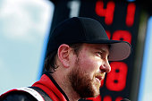 Kurt Busch driver of the Haas Automation Chevrolet looks on from the grid after qualifying for pole position for the NASCAR Sprint Cup Series Axalta...