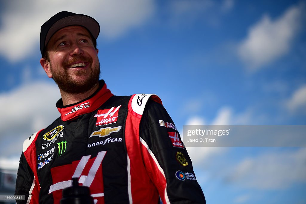 <a gi-track='captionPersonalityLinkClicked' href=/galleries/search?phrase=Kurt+Busch&family=editorial&specificpeople=201728 ng-click='$event.stopPropagation()'>Kurt Busch</a>, driver of the #41 Haas Automation Chevrolet, looks on from the grid after qualifying for pole position for the NASCAR Sprint Cup Series Axalta 'We Paint Winners' 400 at Pocono Raceway on June 5, 2015 in Long Pond, Pennsylvania.