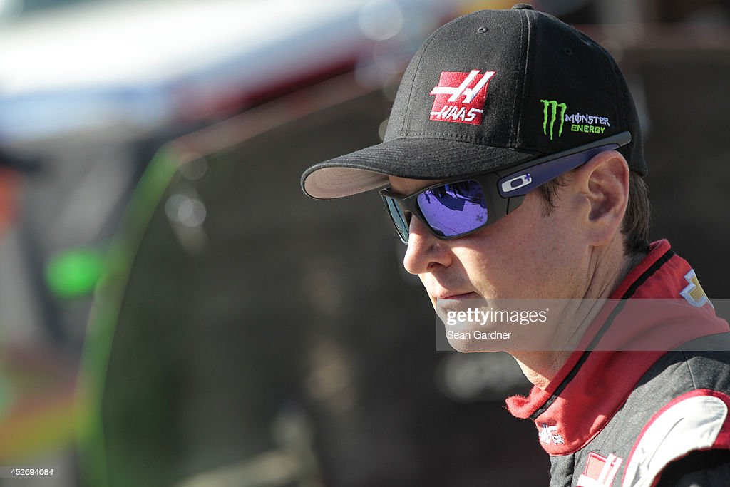 Kurt Busch, driver of the #41 Haas Automation Chevrolet, looks on in the garage area during practice for the NASCAR Sprint Cup Series Quicken Loans 400 at Michigan International Speedway on June 14, 2014 in Brooklyn, Michigan.