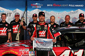 Kurt Busch driver of the Haas Automation Chevrolet poses after winning the Coors Light Pole Award during qualifying for the NASCAR Sprint Cup Series...