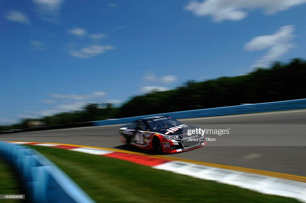 <a gi-track='captionPersonalityLinkClicked' href=/galleries/search?phrase=Kurt+Busch&family=editorial&specificpeople=201728 ng-click='$event.stopPropagation()'>Kurt Busch</a>, driver of the #41 Haas Automation Chevrolet, qualifies for the NASCAR Sprint Cup Series Cheez-It 355 at Watkins Glen International on August 9, 2014 in Watkins Glen, New York.