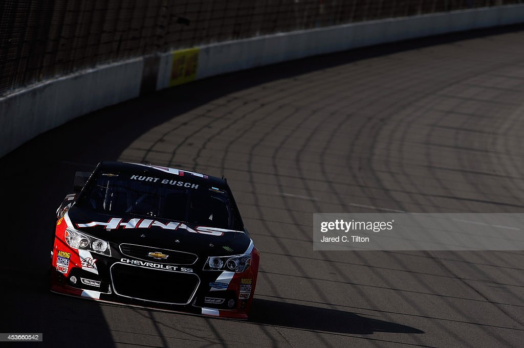 <a gi-track='captionPersonalityLinkClicked' href=/galleries/search?phrase=Kurt+Busch&family=editorial&specificpeople=201728 ng-click='$event.stopPropagation()'>Kurt Busch</a>, driver of the #41 Haas Automation Chevrolet, qualifies for the NASCAR Sprint Cup Series Pure Michigan 400 at Michigan International Speedway on August 15, 2014 in Brooklyn, Michigan.