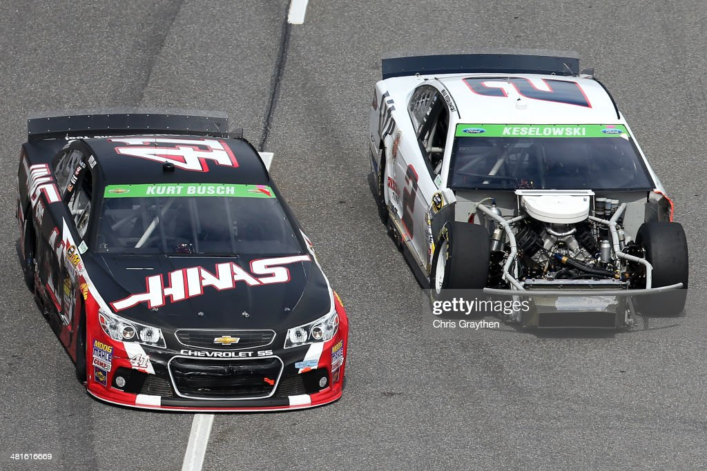 <a gi-track='captionPersonalityLinkClicked' href=/galleries/search?phrase=Kurt+Busch&family=editorial&specificpeople=201728 ng-click='$event.stopPropagation()'>Kurt Busch</a>, driver of the #41 Haas Automation Chevrolet, races <a gi-track='captionPersonalityLinkClicked' href=/galleries/search?phrase=Brad+Keselowski&family=editorial&specificpeople=890258 ng-click='$event.stopPropagation()'>Brad Keselowski</a>, driver of the #2 Miller Lite Ford, during the NASCAR Sprint Cup Series STP 500 at Martinsville Speedway on March 30, 2014 in Martinsville, Virginia.