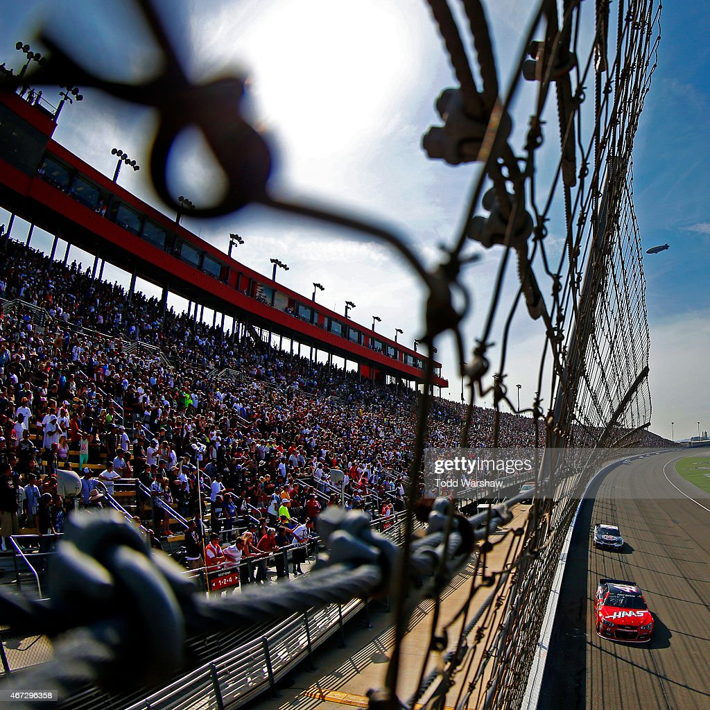 Kurt Busch driver of the Haas Automation Chevrolet races during the NASCAR Sprint Cup Series Auto Club 400 at Auto Club Speedway on March 22 2015 in...