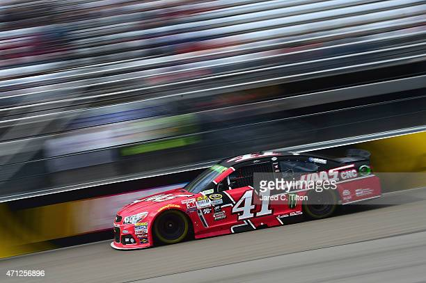 Kurt Busch driver of the Haas Automation Chevrolet races during the NASCAR Sprint Cup Series Toyota Owners 400 at Richmond International Raceway on...