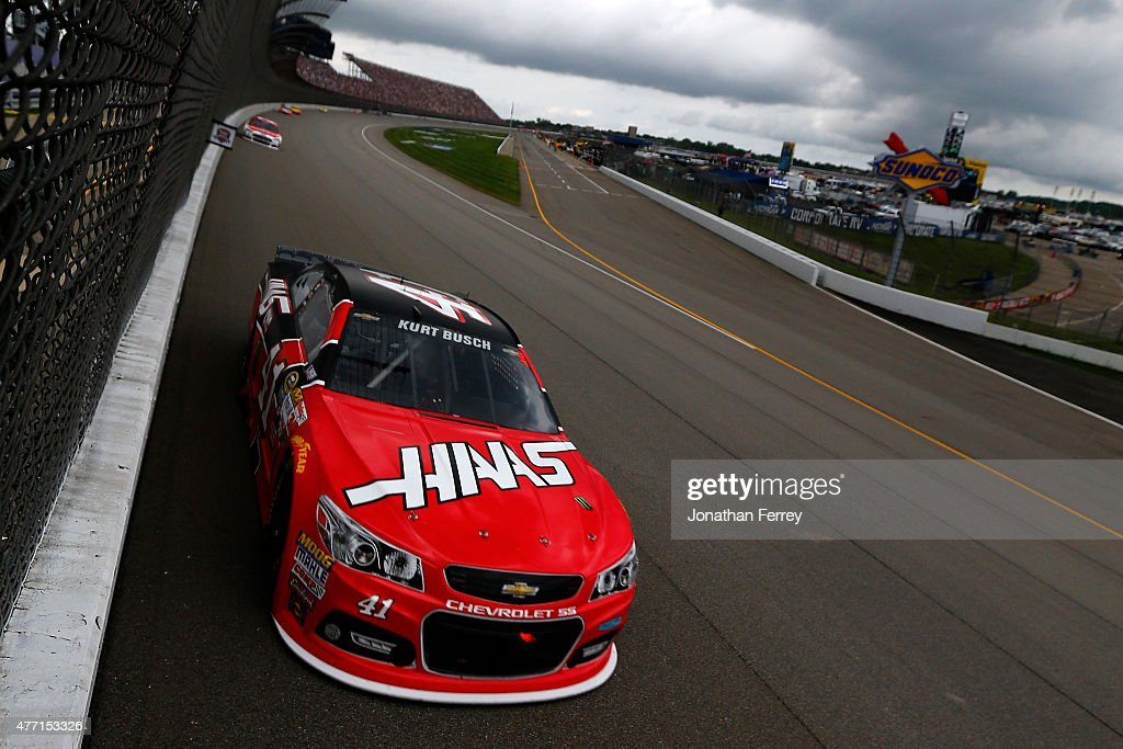 Kurt Busch driver of the Haas Automation Chevrolet races during the NASCAR Sprint Cup Series Quicken Loans 400 at Michigan International Speedway on...