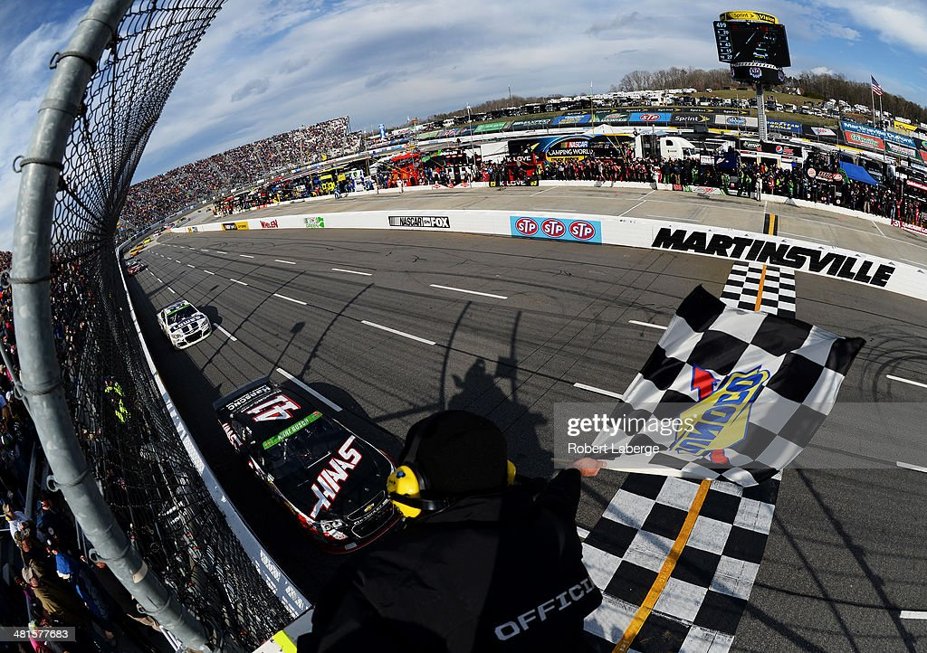 <a gi-track='captionPersonalityLinkClicked' href=/galleries/search?phrase=Kurt+Busch&family=editorial&specificpeople=201728 ng-click='$event.stopPropagation()'>Kurt Busch</a>, driver of the #41 Haas Automation Chevrolet, races to the checkered flag to win the NASCAR Sprint Cup Series STP 500 at Martinsville Speedway on March 30, 2014 in Martinsville, Virginia.